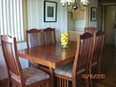 Dining room table opens to seat ten.