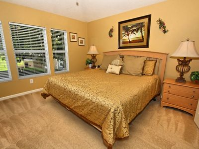 "Master bedroom w/ King size bed, ensuite bathroom,ceiling fan & 32"" flat screen"