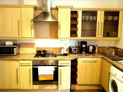 Full Kitchen: coffee, toaster, kettle, gas stove, oven, microwave, pots pans