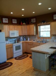 Gatlinburg cabin rental - open kitchen with full appliances