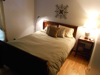 Downstairs Queen Bedroom. Clean linens, blankets & comforters provided. - Harrisonburg house vacation rental photo