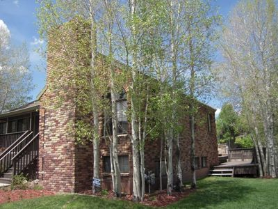 Corner lot with aspen trees and charming brick home