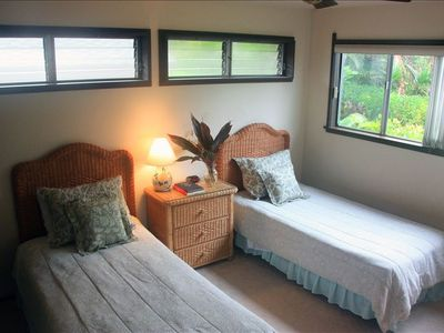 Our 2nd bedroom overlooks a tropical garden.  Beds can be made into one queen.