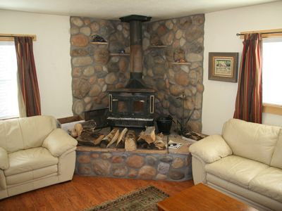 Living room wood stove and leather sofas