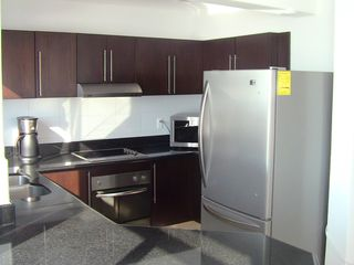 Huatulco condo photo - 5 appliance kitchen with stainless steel appliances and granite countertops.