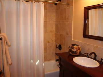 Recently remodeled bathroom w/ travertine bath surround and floor