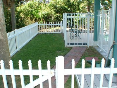 Separately fenced in grassy yard for pets & small children.