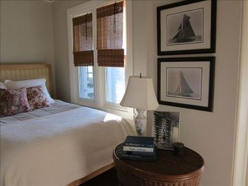 Queen Bedroom ,Capt. Nat's model room. Deck overlooking Harbor and private bath.
