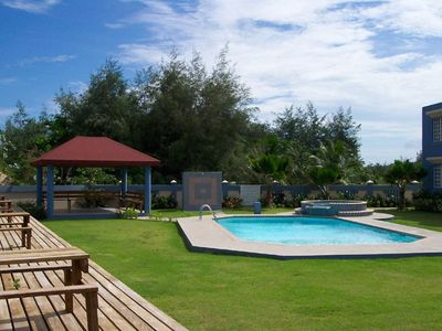 View of swimming pool, jacuzzi, gazebo area