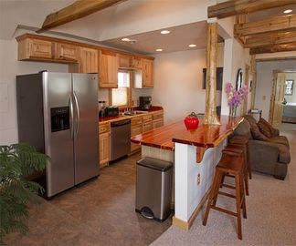 Our fully-equipped kitchen offers convenience for meals and entertainment.