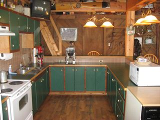 Linwood lodge photo - Fullly equipped kitchen with breakfast bar.