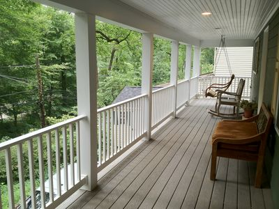 A favorite place to relax is the wrap around porch with a swing & rocking chair