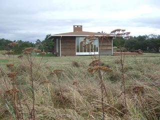 Astoria house photo - A vista of dunes & sea grass awaits as you sip your morning coffee in front room