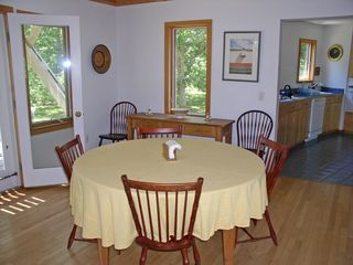 Chilmark house photo - Dining area looking toward the kitchen, porch/deck is to the left