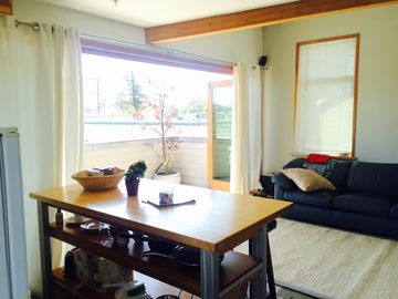 San Luis Obispo studio rental - View of living space and outdoor south facing patio from the front door area.