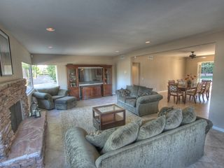 Palm Desert house photo - Living room. Plenty of comfy seating, gas log and big screen TV.