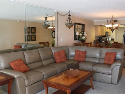 Spacious family room with Lay-Z-boy leather sectional.
