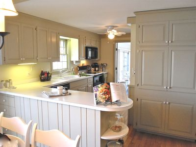 efficient sunny kitchen with lots of counter space for buffets