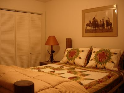 Queen bed ~ new carpet in living room & bedroom. Small TV on log dresser