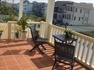 Relax on the large deck. - Da Nang villa vacation rental photo