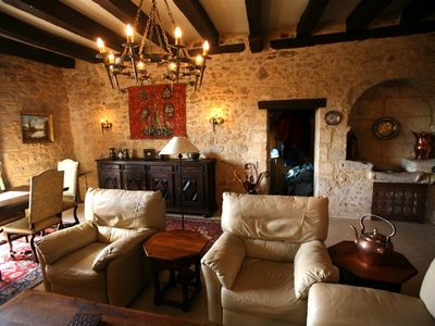 Relax in the comfort of your medieval retreat with leather club chairs and sofa