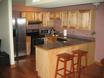 Stainless Kitchen with Granite and Hickory