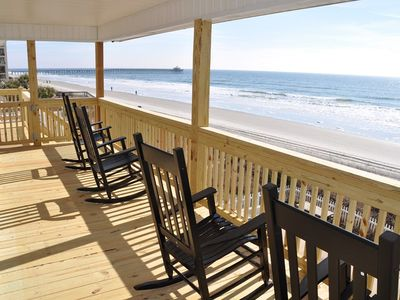 Rocking chairs overlooking the beach, ocean and Cherry Grove Pier.