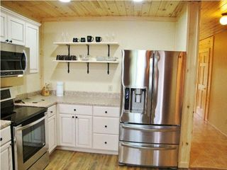 Burt Lake cabin photo - French door refrigerator w/ice and water and double drawer freezer..
