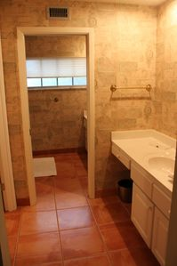 Master bath w dressing area & walk-in closet and 2nd sink. Ceramic tile shower