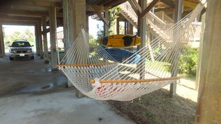 Galveston house photo - Hammock on ground floor with Kayaks in background.