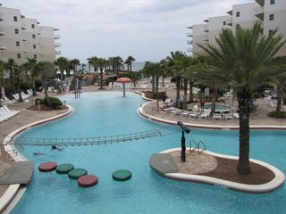 Fort Walton Beach condo photo - Tropical oasis with the zero-entry pool, Lay-Z-River, and chidren's splash area.