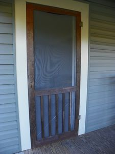 Front screen door with an inviting squeak!