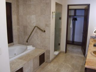 Master Bath with separate tub (jets) / shower accented in marble. Double sinks. - Cabo San Lucas villa vacation rental photo