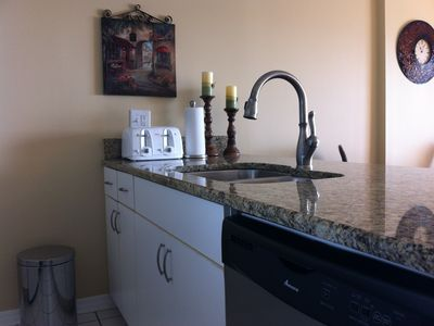 Granite counter with a new Stainless Steel Dish washer...