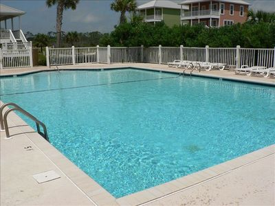 One of two large swimming pools with tennis courts too!