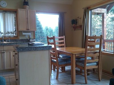 Dining with a view in our new kitchen with granite counters.