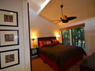 Lahaina condo photo - Bedroom with king sized bed overlooks the beautiful garden pool.