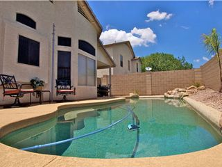 Gilbert house photo - Private Pool has a Rock Waterfall Feature and Plenty of outdoor seating.