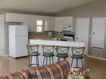Additional seating in kitchen provides room for 8 people to dine together.
