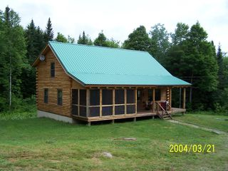 Milan cabin photo - Linger longer log cabin on 102 acres. Note the screened in porch.