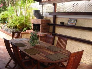 Dorado house photo - Chalets de Dorado del Mar - Covered patio table for six with BBQ