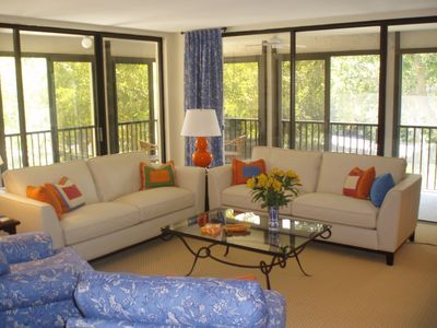 living room, looking through wraparound lanai with two sets of sliders