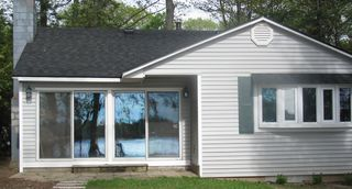 Traverse City cottage photo - Neat and clean Cottage with reflection of lake.