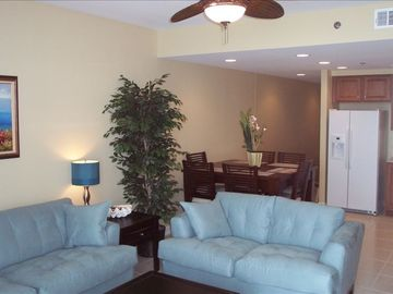 Gulf Resort Beach condo rental - Family room and dining area overlooking the Gulf of Mexico