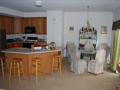 Kitchen w/ Island & Dining Room