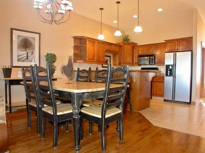 Dining area, seating for 9 including 3 bar stools at large kitchen counter bar.