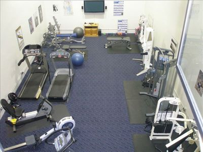 Exercise room in the clubhouse next to the large pool and tennis courts.