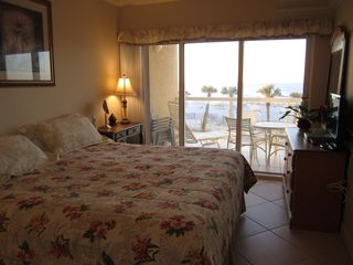 Pensacola Beach condo photo - Master Bedroom looks out to balcony and Gulf seascape