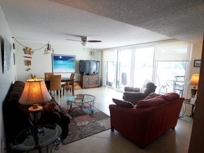 "Living Room has plenty of comfortable seating and a 55"" Flat Screen, and DVD"