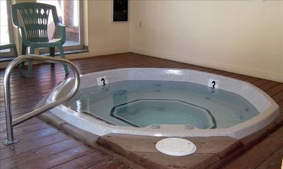 The indoor hot tub located in the pool house